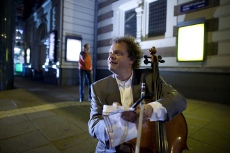 Cello Player ANDERS DAVIDSON with pipe, in front of Concertgebouw Amsterdam & d.o.p. Mick Durlacher